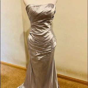 Silver beaded gown with lace up back and train